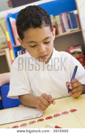 Portrait Of Child Learning Numeracy