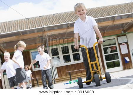 Children Playing In School Playground