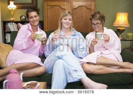 Girlfriends Drinking Tea On Sofa