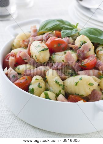 Bowl Of Gnocchi With A Bacon Tomato And Basil Dressing