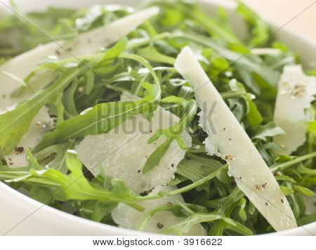 Salad Of Roquette Leaves And Parmesan Shavings With Olive Oil