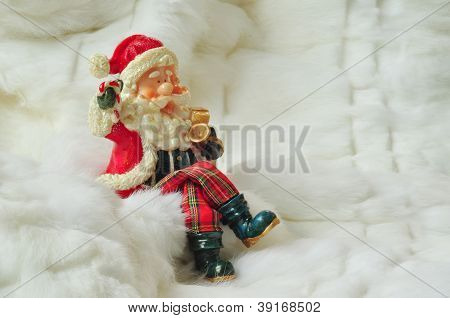 Santa Claus Sitting On White Fur With Space For Text Writing