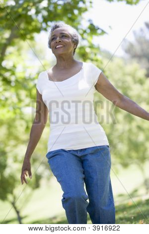 Senior Woman Walking In Park