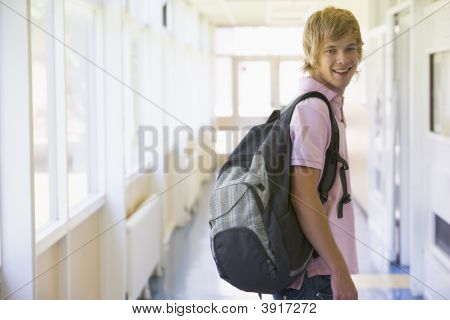 Student Standing In Corridor (Selective Focus)