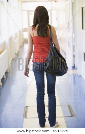 Student Standing In Corridor (High Key)