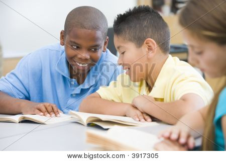Students In Class Reading Together (Selective Focus)