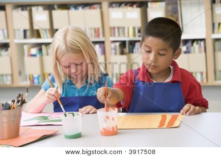 Two Students In Art Class Painting