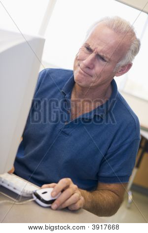Man At Computer Looking At Monitor Confused (High Key)