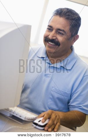 Man At Computer Smiling And Looking At Monitor (High Key)