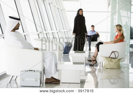 Airline Passengers Waiting In Departure Gate