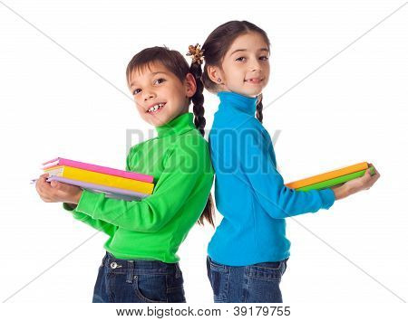 Kids standing with stack of books