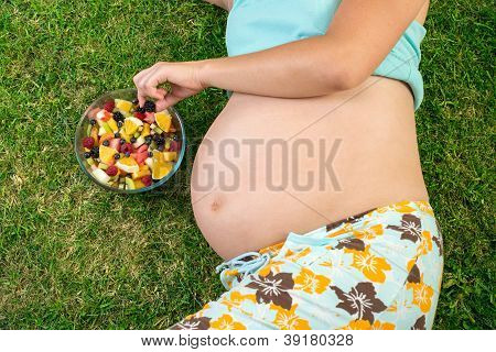 Pregnant Woman With Fruit