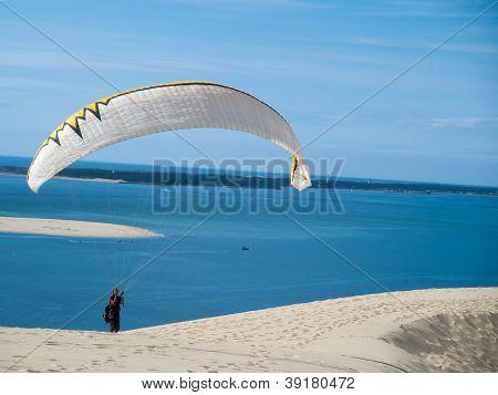 Caucasian Man Paragliding