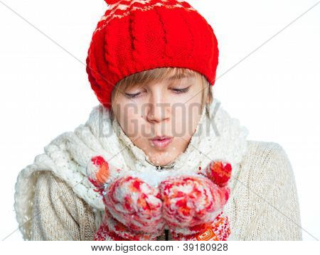 Young frozen teenager in winter style with snow