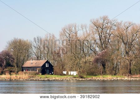 Wooden lodge near water