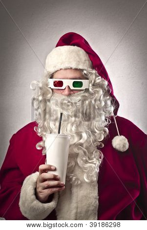 Santa Claus drinking a soda and wearing tridimensional glasses