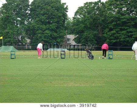 People on a golf training course