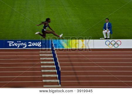 Woman Jumps Hurdles At Olympics