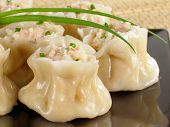 stock photo of siomai  - A plate of steamed Chinese shrimp siu mai - JPG