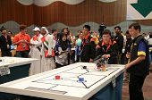 SUBANG JAYA - NOVEMBER 10: Unidentified team members prepare their robot for the competition at the