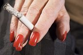 Red Fingernails And Cigarette (front View) poster