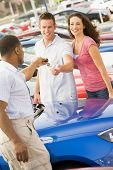 stock photo of hair integrations  - Young couple shopping for a car - JPG