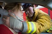 image of accident emergency  - Fireman helping woman with neck brace  - JPG