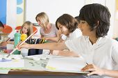 stock photo of tweeny  - Students in art class with  - JPG