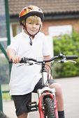 Boy Leaving School On Bike