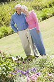 foto of old couple  - Senior couple in a flower garden - JPG