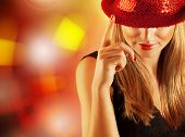 stock photo of  dancer  - Photo of gorgeous dancer female with finger up on the stage in disco club - JPG