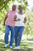 picture of elderly couple  - Senior couple walking in park together - JPG