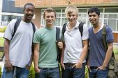 image of late 20s  - Group of students outdoors looking at camera smiling - JPG