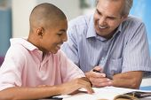 image of personal assistant  - Teacher giving personal instruction to male student - JPG