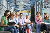 stock photo of hair integrations  - Students study group with teacher - JPG