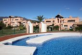 stock photo of urbanisation  - Vacation resort with pool in Andalusia Costa del Sol Spain - JPG