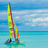 VARADERO,CUBA-NOVEMBER 3:Young couple sailing on a catamaran November 3,2012 in Varadero.With over a