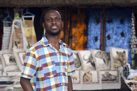 stock photo of curio  - African small business curio salesman selling ethnic items in Howick KwaZulu - JPG