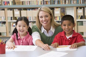 foto of student teacher  - Two students in class with teacher - JPG