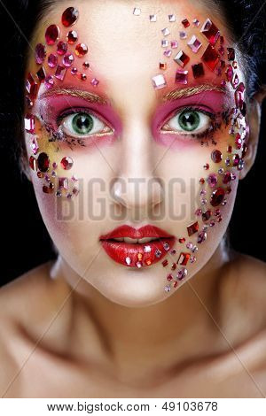 Closeup portrait of woman with artistic make-up. Luxury image.
