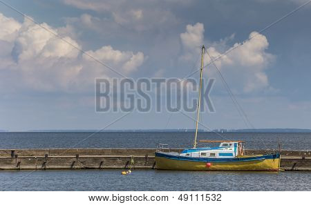 Blue And Yellow Boat On The Curonian Spit