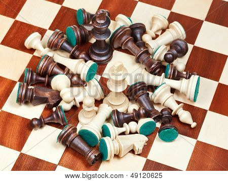 King In Middle Of Spillage Of Chess Pieces