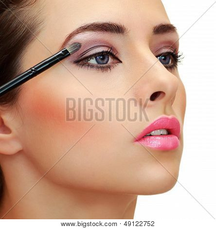 Eyes Makeup. Brush Applying Eye Shadows On Beauty Woman Face. Closeup