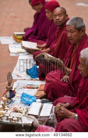 Monks Praying At Bouddanath Temple In Kathmandu