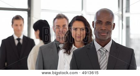 Five Person Business Team Looking At Camera And Smiling