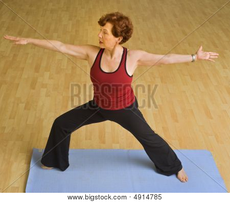 Senior Woman Exercising Yoga
