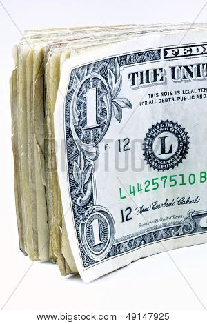 Stack Of One Dollar Bills On Its Side