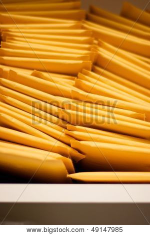 Vertical Pile Of Padded Shipping Envelopes