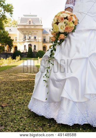 Bride And Her Bouquet In The Park.