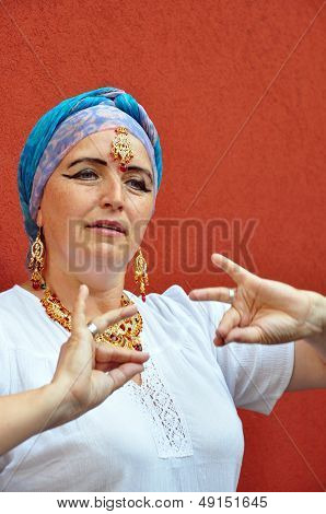 Woman With Indian Necklace, Earrings And Tikka